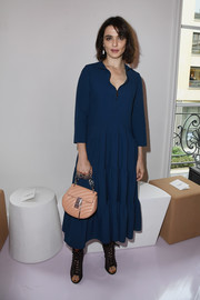 Rachel Weisz went boho in a loose, tiered midi dress with a zip-up neckline for the Chloe fashion show.