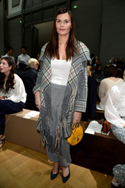 Marina Hands attended the Chloe fashion show wearing a fringed plaid wool coat.