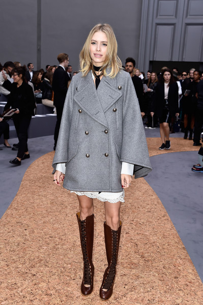 Knee-high lace-up boots added a retro touch.