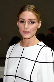 Olivia Palermo styled her locks into a classic center-parted chignon for the Chloe fashion show.