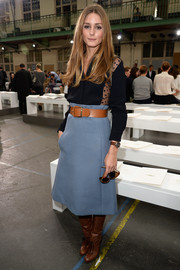 Olivia Palermo channeled the '70s in a blue A-line skirt, a button-down, and boots at the Chloe fashion show.