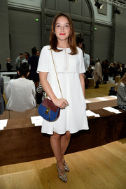 Anais Demoustier added a pop of color with a blue and maroon chain-strap bag by Chloe.