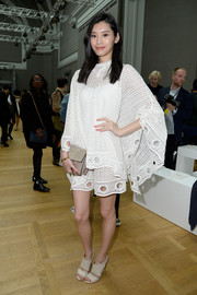 Ming Xi complemented her white separates with a pair of nude wide-strap sandals.
