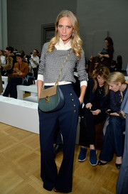 Poppy Delevingne paired her top with nautical-chic gold-buttoned blue pants by Chloe.