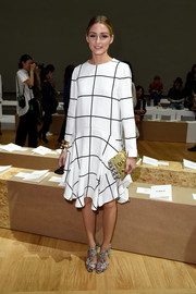 Olivia Palermo chose a black-and-white grid-print shift dress for the Chloe fashion show.