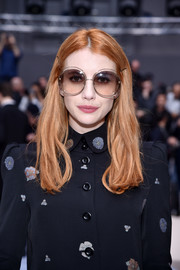 Emma Roberts amped up the retro feel with a pair of oversized round sunnies by Chloe.