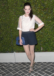 Roxane Mesquida teamed navy shorts with her top for a youthful finish.
