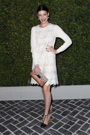 Jessica Pare looked modest in a floral-embroidered, long-sleeve white shift at the Chloe LA fashion show and dinner.