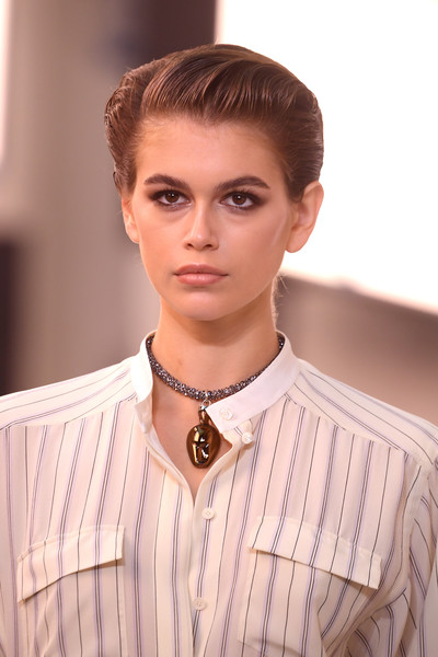Kaia Gerber accessorized with a chic bronze pendant.