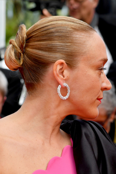 Chloe Sevigny Twisted Bun [hair,hairstyle,ear,chignon,bun,chin,neck,blond,long hair,ponytail,chloe sevigny,once upon a time in hollywood,screening,cannes,france,red carpet,the 72nd annual cannes film festival,cannes film festival]