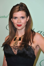 Carly paired her lace embellished dress with a bronze statement necklace.