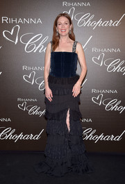 Julianne Moore opted for a flirty two-tone Sonia Rykiel gown, featuring a corseted velvet bodice and a tiered ruffle skirt, when she attended the Chopard dinner in honor of Rihanna.