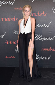 Pixie Lott put on a racy display in a black-and-white Dsquared2 halter gown, featuring a sheer skirt with a hip-high slit, at the Chopard Gent's Party.