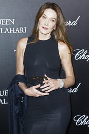 Carla Bruni-Sarkozy made an appearance at the 'Garden of Kalahari' movie presentation carrying a chic beaded clutch to match her black dress.