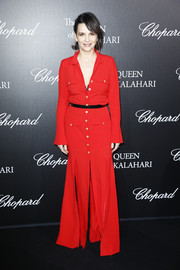 Juliette Binoche went for relaxed elegance in a red maxi shirtdress at the 'Garden of Kalahari' movie presentation.