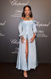 Rihanna hit the Chopard Space Party wearing a custom Adam Selman gown featuring a corseted bodice and an up-to-there slit.