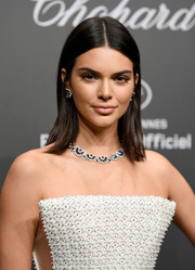 Kendall Jenner dolled up her bare neckline with a gemstone collar necklace by Chopard.