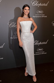 Kendall Jenner exuded modern glamour at the Chopard Space Party in this embellished silver Ralph & Russo Couture gown featuring an angular strapless neckline.