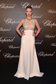 Anya Taylor-Joy was sultry and sophisticated in a peekaboo halter gown by Miu Miu at the Chopard Trophy photocall.