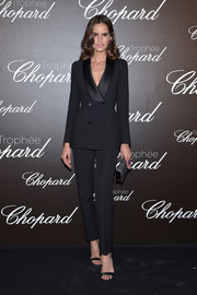 Izabel Goulart looked flawless in this impeccably tailored tuxedo at the Chopard Trophy photocall.
