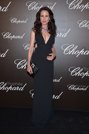Andie MacDowell was sexy and trendy in a plunging black cutout gown at the Chopard Trophy photocall.