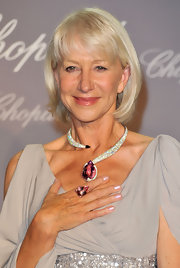 Actress Helen Mirren showed off her decadent jewelry while attending the Chopard Trophy event in Cannes.