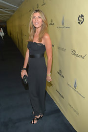 Nina Garcia showed her sexier side with a slinky black strapless dress at the 2013 Golden Globes after-party.