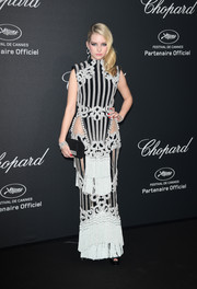 Lottie Moss' Balmain dress at the Chopard Wild Party was an eyeful, from the fringed skirt to the hip cutouts to the pearl embellishments and swirly embroidery.