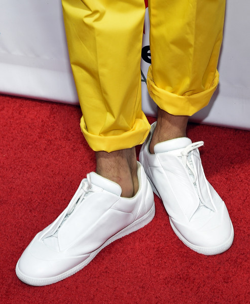 Chris Brown Leather Sneakers [shoe,footwear,white,yellow,sneakers,sportswear,athletic shoe,plimsoll shoe,trousers,human leg,chris brown,backstage,detail,las vegas,nevada,caesars palace,iheartradio summer pool party,the iheartradio summer pool party]