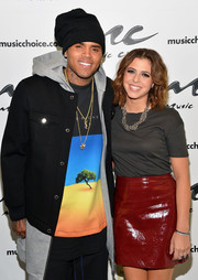 Chris Brown topped off his outfit with a classic black cap.