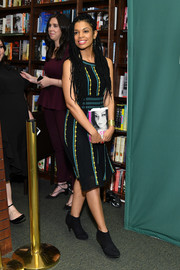 Susan Kelechi Watson donned a black knit midi dress with yellow and teal trim for Chrissy Metz's book signing.