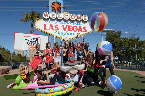 LVCVA And Sports Illustrated Models Support NCAA Basketball Conference Championship At Historic Las Vegas Sign