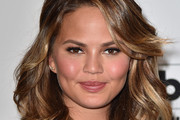 Chrissy Teigen Medium Wavy Cut with Bangs