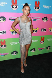 Tinashe looked dazzling in a silver mini dress with a net overlay at the Christian Cowan x The Powerpuff Girls show.