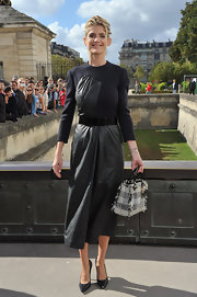 Alice's unique leather dress was a perfect fit for the Christian Dior fashion show in Paris.
