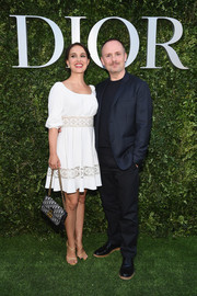 Natalie Portman charmed in a white lace-panel peasant dress by Dior during the label's '70 Years of Creation' exhibition.