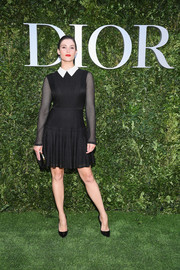 Gemma Arterton was preppy in a Dior LBD with a contrast collar and sheer sleeves during the label's '70 Years of Creation' exhibition.