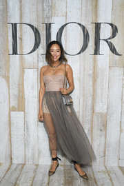 Aimee Song pulled her look together with a silver chain-strap bag by Dior.