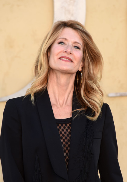 Laura Dern looked lovely with her windswept waves at the Dior Cruise 2018 show.