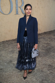 Freida Pinto completed her all-Dior look with a quilted gray purse.
