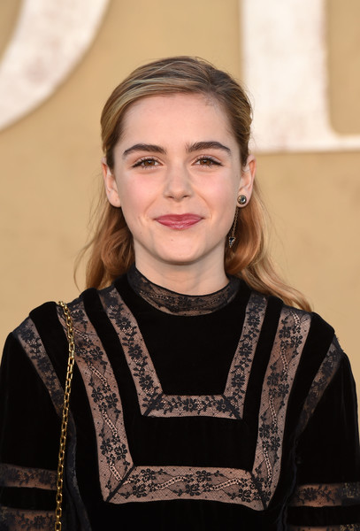 Kiernan Shipka kept it youthful with this half-up hairstyle at the Christian Dior Cruise 2018 show.