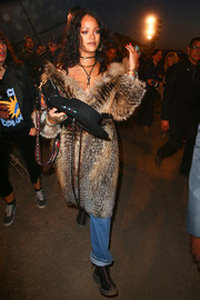 Rihanna arrived in style at the Dior Cruise 2018 show wearing a fox-fur coat from the label.