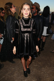 Kiernan Shipka was classic and cute in a velvet and lace LBD by Dior during the label's Cruise 2018 show.