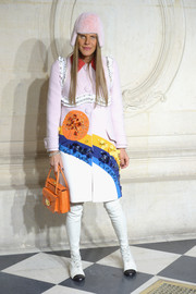 Anna dello Russo went for a colorful retro look in an embellished Prada coat during the Christian Dior fashion show.