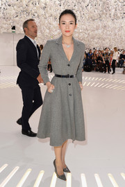 Sticking to a monochromatic motif, Zhang Ziyi teamed her coat with a pair of Dior pumps.