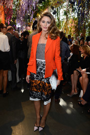 Olivia Palermo really knows how to mix her prints. At the Christian Dior fashion show, she matched a lace skirt with a houndstooth bustier, with chic results.