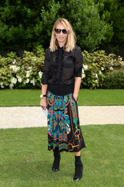Alexandra Golovanoff's calf-length print skirt added a vibrant touch to her dark top.