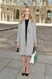 Natalie Dormer kept it modest in a gray tweed coat when she attended the Dior fashion show.