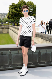 Harry opted for a white tee with black polka dots for the Christian Dior Haute Couture runway show.