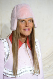 Anna dello Russo made a relatively tame (but still funky) choice with this pink mad bomber during the Christian Dior fashion show.